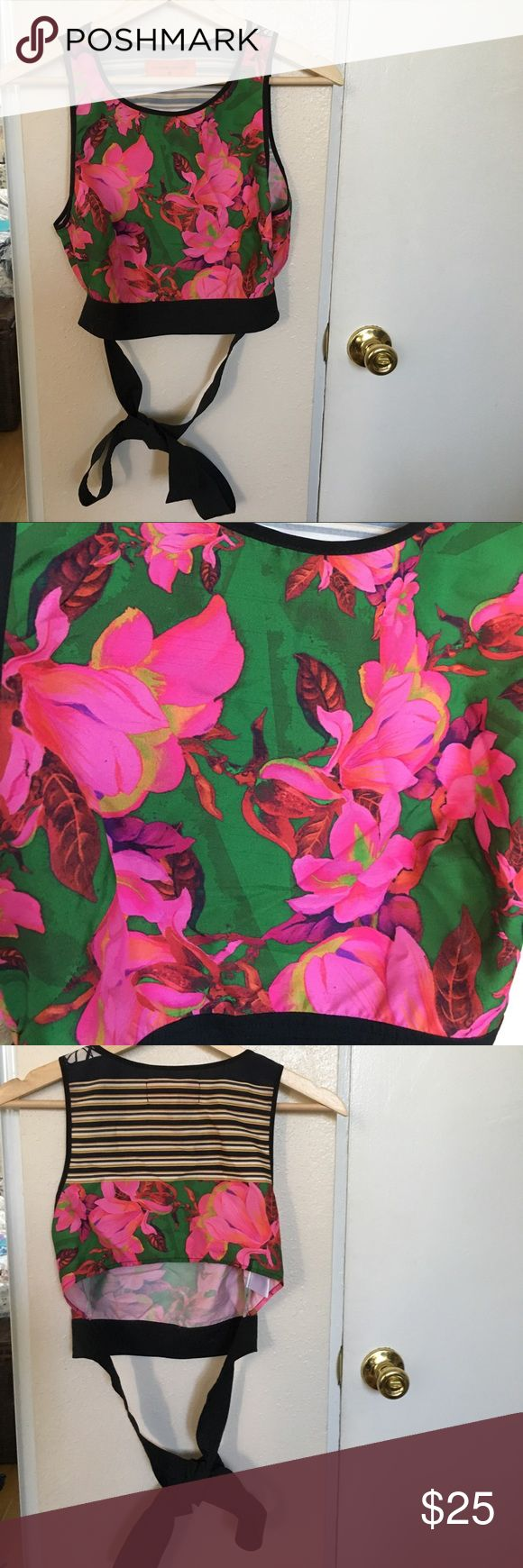 Clover Canyon floral crop top with ribbon Small crop top with a ribbon that ties around the waist. Material good for the summer since it's thin and breathable. Only worn a few times and makes a good addition to any summer or spring wardrobe! Clover Canyon Tops Crop Tops