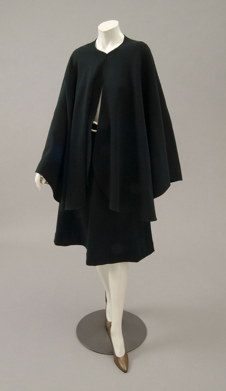 Woman's ensemble: skirt, cape and belt   Designed by Roy Halston Frowick, known as Halston (American, 1932-1990)   United States, mid-1970's   Forest green wool blend knit, off-white plastic   Philadelphia Museum of Art