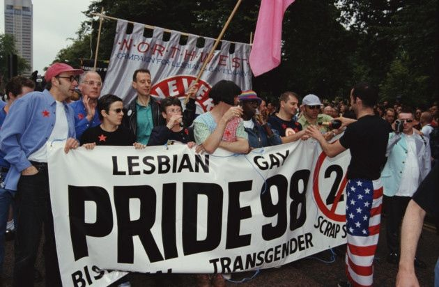 Comedian Rhona Cameron and political activist Peter Tatchell help to hold a banner at the Lesbian, Gay, Bisexual, and Transgender Pride event in 1998 calling for an end to Section 28. Photo by Steve Eason / Hulton Archive / Getty Images.