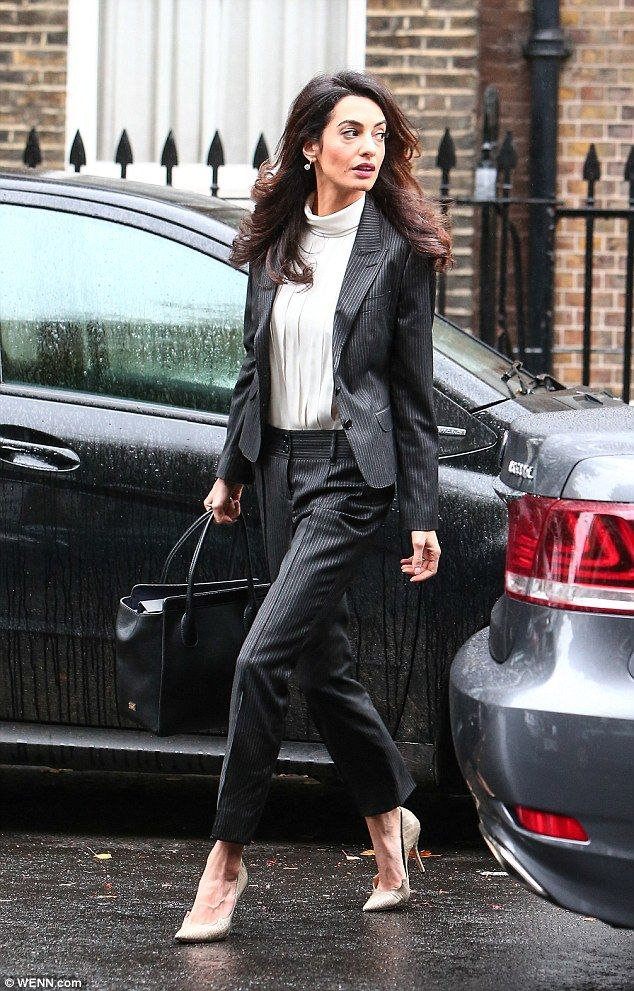 Leggy look: The37-year-old human rights lawyer accentuated her slender legs with nude sti...