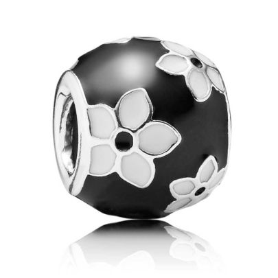 Pandora Silver Enamel Black White Enamel Flowers 791398ENMX. An attractive sterling silver bead decorated with wonderfully smooth black and white enamel. A stylish bead adorned with floral patterns and a sophisticated finish perfect for your bracelet.
