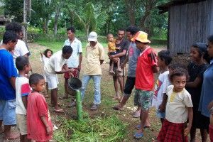 Permatil workshop demonstrating using a bamboo watering pipe for fruit trees
