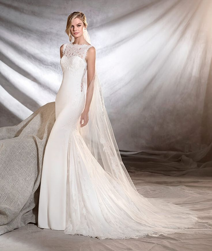 Pronovias Oreste bridal gown. Suggestive empire line mermaid wedding dress with…