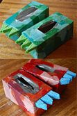 DIY dino feet craft using used tissue boxes.