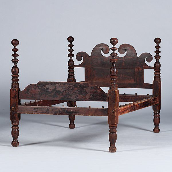 Ohio Cannonball Bed  Ohio, 19th century. A full size cannonball bed in early paint having a scrolled headboard and shaped footboard; ht. 53.5, wd. 54, lg. in.