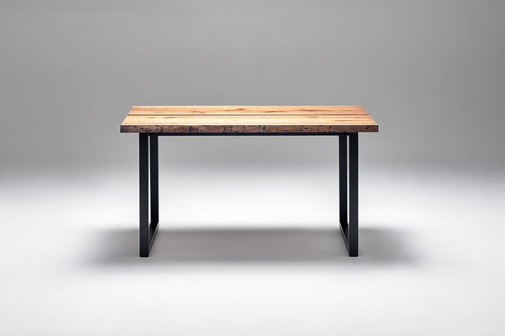 Nevian dining table; Edge. Dark oak and black steel base.