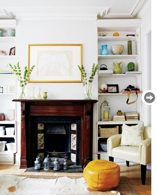 The bookcases flanking the fireplaces were lovingly built by homeowner Paul Kilbacks's father and brother. Adding inexpensive dental moulding to the top makes them seem like they were always part of the house.
