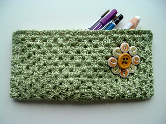crochet pencil case by cornflowerbluestudio, via Flickr - easy. one large granny square, folded and lined with zipper