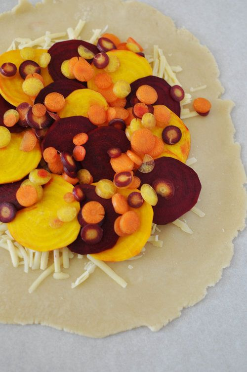 This recipe for a beet and carrot galette with gouda is rustic, earthy, and  delicious. It's easy to make, especially if you have a mandoline. I was  able to find a mix of colorful beets and carrots, and that helped make this  dish even prettier.  We had a good friend over for dinner this weekend and I was telling him how  excited I am about this beet galette and he started laughing and reminded  me that I hate beets. So much so that I ditched him on our juice cleanse (3  years ago) over…