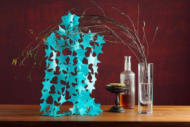 sternen girlande aus papier scherenschnitt basteln. Black Bedroom Furniture Sets. Home Design Ideas