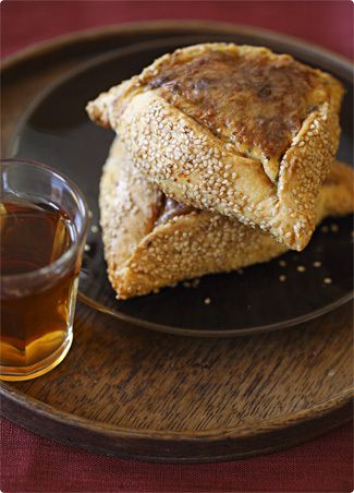 Flaouna or flaounes in the plural (φλαούνα and φλαούνες respectively in Greek, is a special Easter food eaten on the island of Cyprus by the mainly Orthodox Greeks. They are a cheese filled pastry, which sometimes also include raisins or can be garnished with sesame seeds. They traditionally serve to break the Lenten fast.