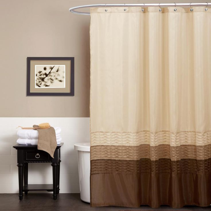 This sunny shower curtain features three bright tones to beautify the bathroom. Fabricated with faux silk, the surface comes alive with pieced fabrics of taupe, brown and cream complemented with a pleated design running the width of the curtain.