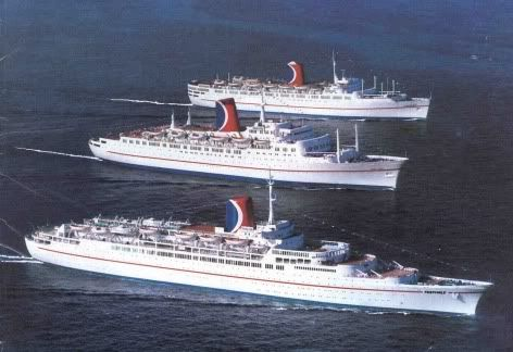 The three original cruise ships of Carnival Cruise lines, sailing together at sea: Festivale, Carnivale and the Mardi Gras