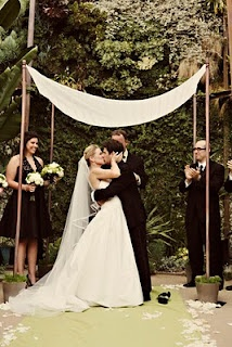 Wedding chuppah Simple, simple, simple and yet brings proper focus to ceremony in a large venue.