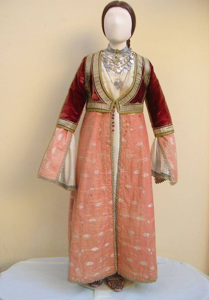 """Front and back, a jacket detail from a unique costume of Pyrgos, Ileia, characterized by the """"anteri"""" coat dress and the """"kondogouni"""" jacket which evolved later in the """"Amalia"""" costume.  http://www.texmedindigitalibrary.eu/?browse=location=9"""