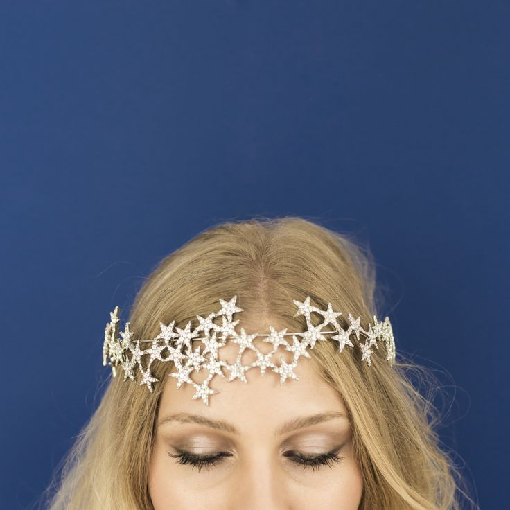Product Info:New for A/W16! Sparkling crystal encrusted cascading star crown on a rigid silver wire base with elastic, ribbon, or bobby pin attachment. Perfect for party season, bridal or just ...