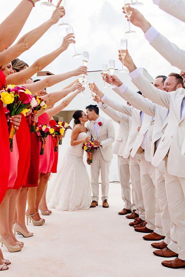 Fun wedding photo idea toasting to the newlyweds (Photo by Melissa Mercado Photography)