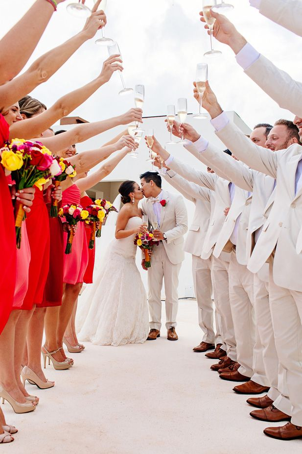 Fun wedding photo idea toasting to the newlyweds (Photo by Melissa Mercado Photography)