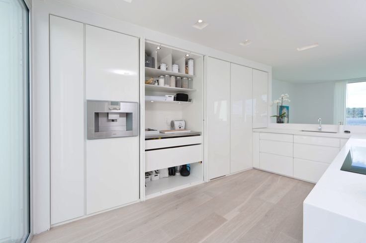 Glossy white Boform Line kitchen with pocket doors
