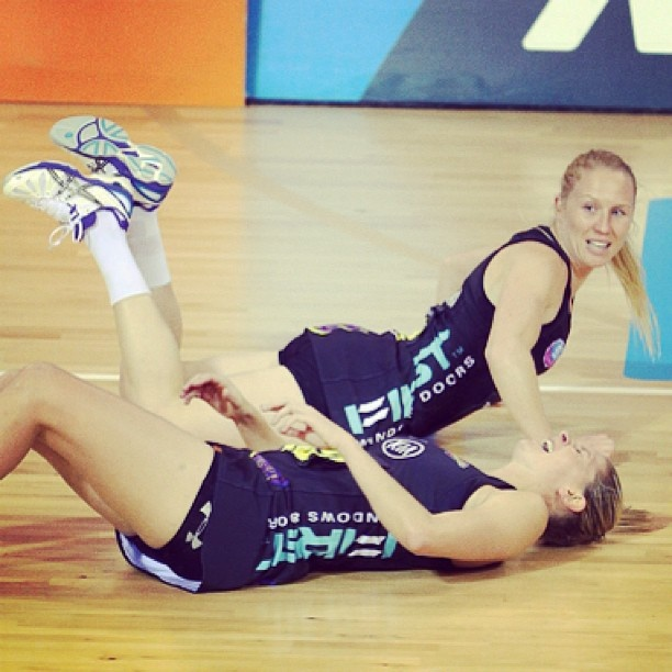 Photo of the Round: Magic's Laura Langman and Casey Kopua spill on to the court during play #anzchampionship