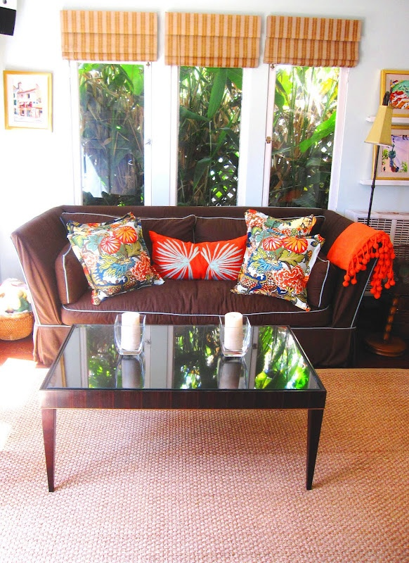 Love the chocolate colored couch with spouts of bright colored pillows..via  www.