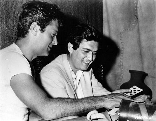 Tony Curtis shows director Stanley Kubrick some card tricks on the set of Spartacus