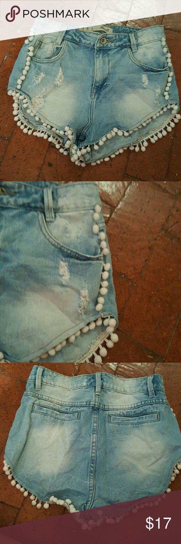 Pom Pom Jean Shorts Size 4 jean shorts with whit pom pom embellishments and a bit of distress. Real pockets Great condition, worn once 100% cotton Shorts Jean Shorts