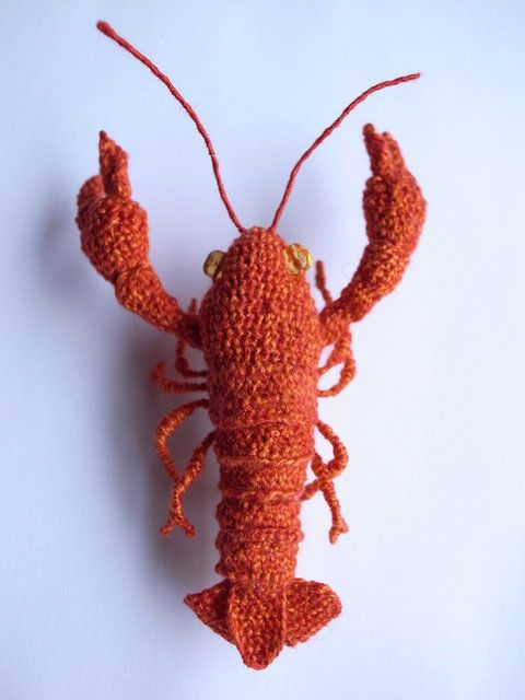 kaoru hirota, the Japanese embroidery artist who uses 'Hipota' as her maker name. Her miniature objects appear to be crocheted but are a 3D type of embroidery made with a strong sewing needle called a Nuibari. Many of her creations reflect the natural world, often with little touches of humor: animals, birds, sea creatures, vegetables and fruits. Here, a wee Lobster. (She's also the artist who embroiders hyper-realistic kittens peeping out of shirt pockets.)