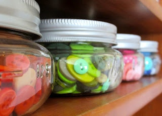 half-pint canning jars for button organization -- already doing this. Works great!