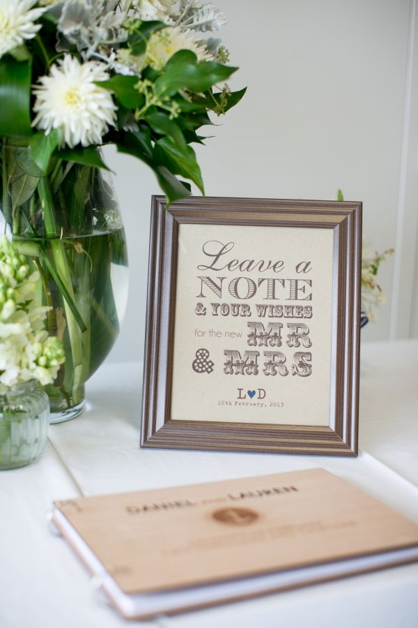 A traditional wood-bound wedding guestbook (Photo by Lizzy C Photography)