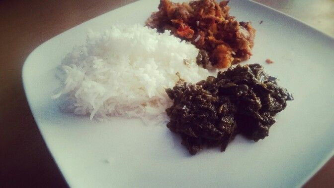 Fried tomato fish with greens and white basmati rice