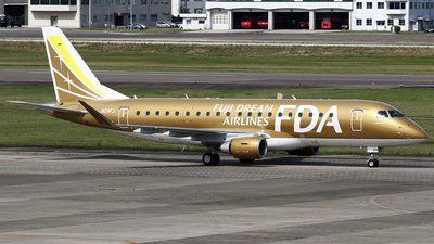Fuji Dream Airlines-FDA (JP) Embraer ERJ-175 JA09FJ aircraft, skating at Japan Nagoya Airfield (Nagoya Komaki). 21/04/2015. (The Golden colored plane).
