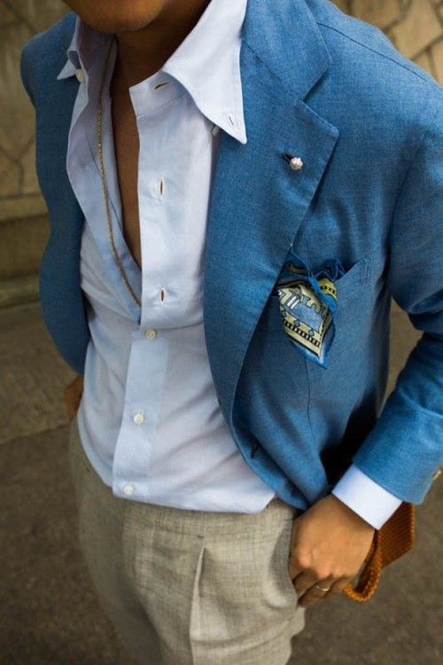 Shop this look for $134:  http://lookastic.com/men/looks/blue-blazer-and-light-blue-dress-shirt-and-grey-dress-pants-and-blue-pocket-square/1734  — Blue Blazer  — Light Blue Dress Shirt  — Grey Dress Pants  — Blue Print Pocket Square
