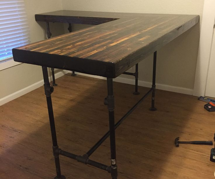 These are instructions for how to build a standing desk out of 2x4s and iron plumbing pipe. I recently built the L-shaped desk seen in the picture which I will use for this tutorial. I will also include suggestions for customizing the build to your own specifications.