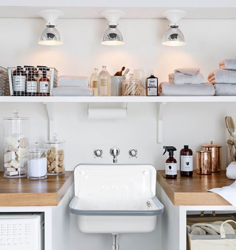 sink from Rejuvenation, wall mount faucet, laminate butcher block countertops, custom storage, shelf above