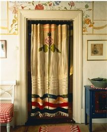 "embroidered high design curtains instead of closet doors.  ""Karin did all the linens, weaving, embroidery, design...in the Carl Larsson home."""