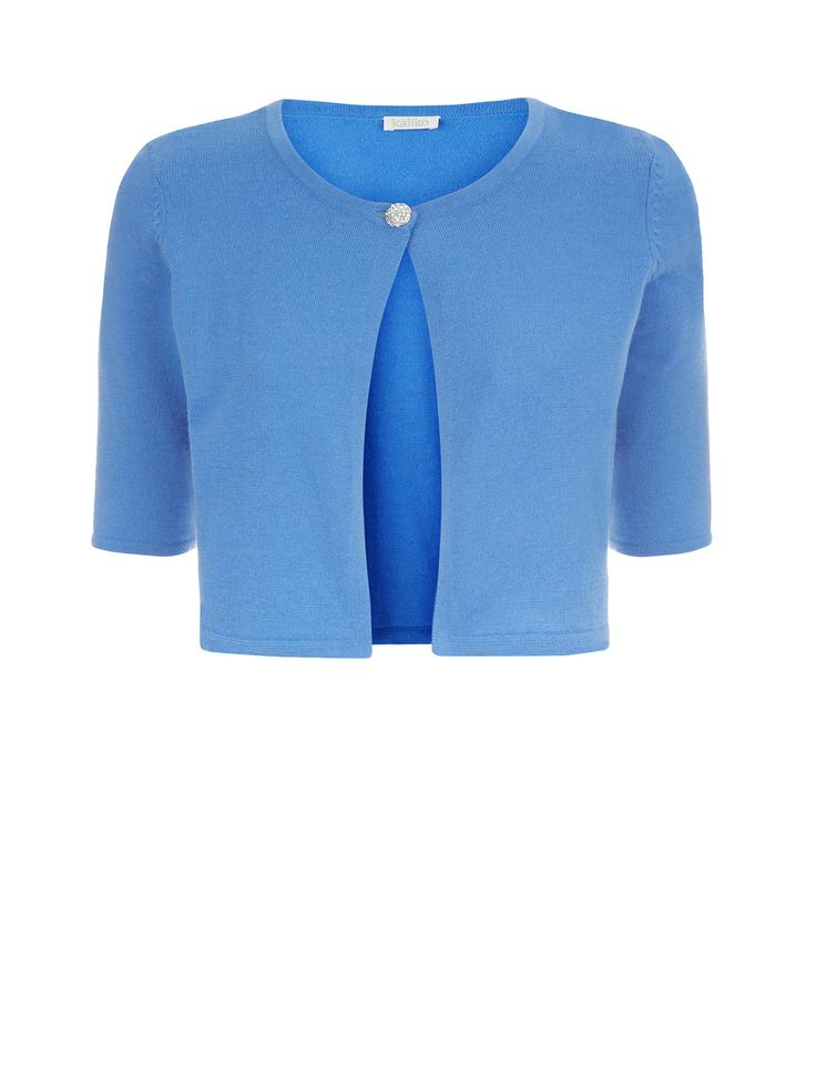Now reduced to €39!! In a lovely bluebell shade, this little shrug features a diamanté button for a lovely finishing touch. Perfect for wearing over dresses €65.