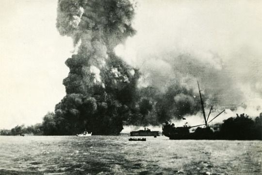 The cargo ship Neptuna explodes as the Japanese bomb Darwin, Australia. This was the first attack on the Australian mainland which would be followed by 96 more raids throughout the war. February 1942