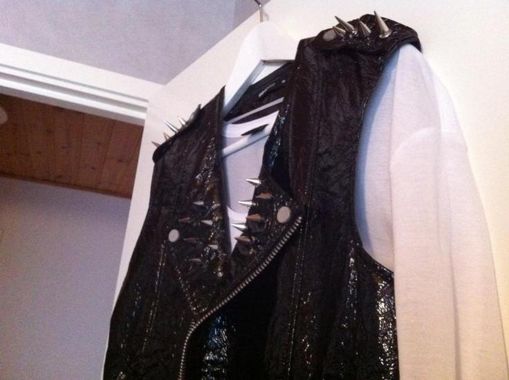 A shiny biker vest that I customized with studs