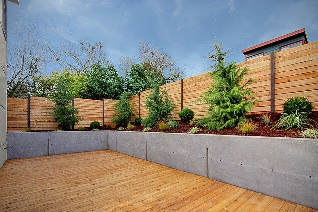 how to build a fence on a retaining wall