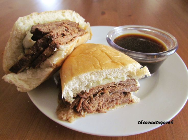 Slow Cooker French Dip Sandwiches  Ingredients: 3-4 lb. Beef Round Steak (or any type roast) 1 packet Onion Soup Mix 1 packet Au Jus Seasoning 1 (15 oz) can of Beef Broth or Stock ½ cup water 4 slices mozzarella cheese Sub rolls  instead of the water, substitute with more beef stock if you like