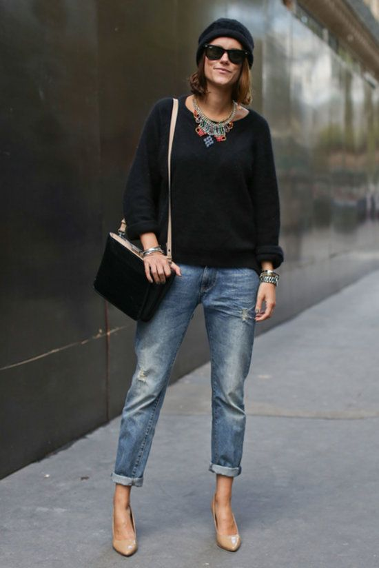 Baggy jeans with a statement necklace and nude pumps