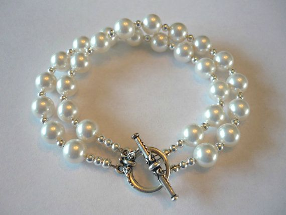 A double strand bracelet, white Swarovski pearls and sterling silver beads.  #pearls #wedding #bride #bridal #jewelry #pearl #bracelet