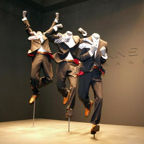 """Now, that's energetic! Love the styling details (flying ties, etc) that support the mannequins' """"action""""."""