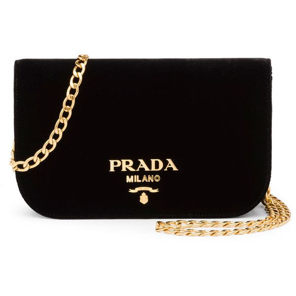 Prada velvet crossbody bag with golden hardware.  Removable chain shoulder strap, 20 drop.  Flap top with logo lettering; snap closure.  Interior, leather lini…