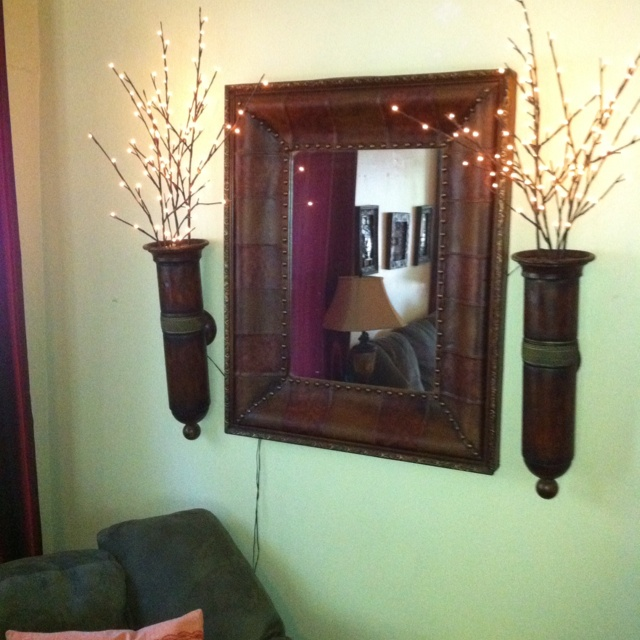 I'm obsessed with twinkle lights! Although I do still need to figure out a way to hide these wires....   I found the mirror, sconces, and willow tree branch twinkle lights in a little shop at Larry's Old Time Trade Days in Winnie, TX.