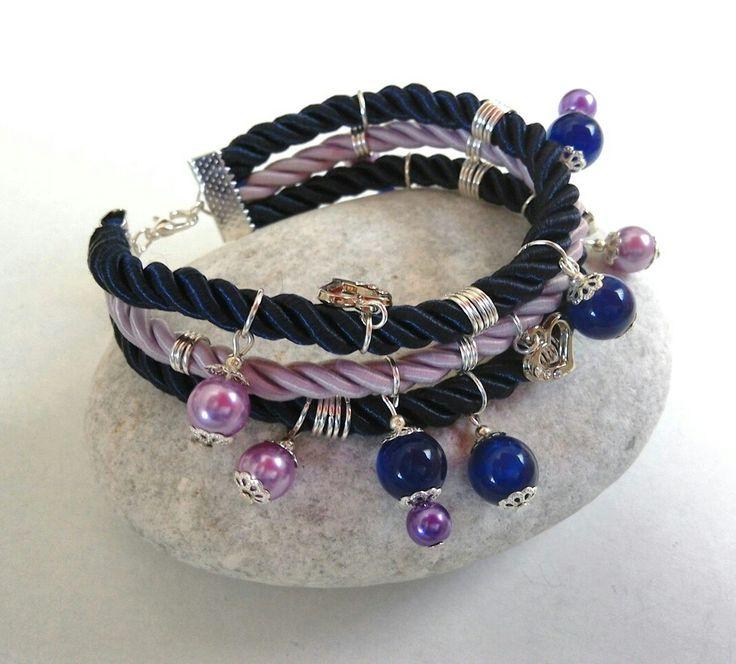Lilac and blue cord bracelet with charms. https://m.facebook.com/ElitasBijoux?ref=hl&__nodl