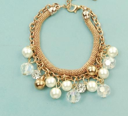Gold charm bracelet with pearls that can be worn on on regular basis. - £8.99 - In Stock