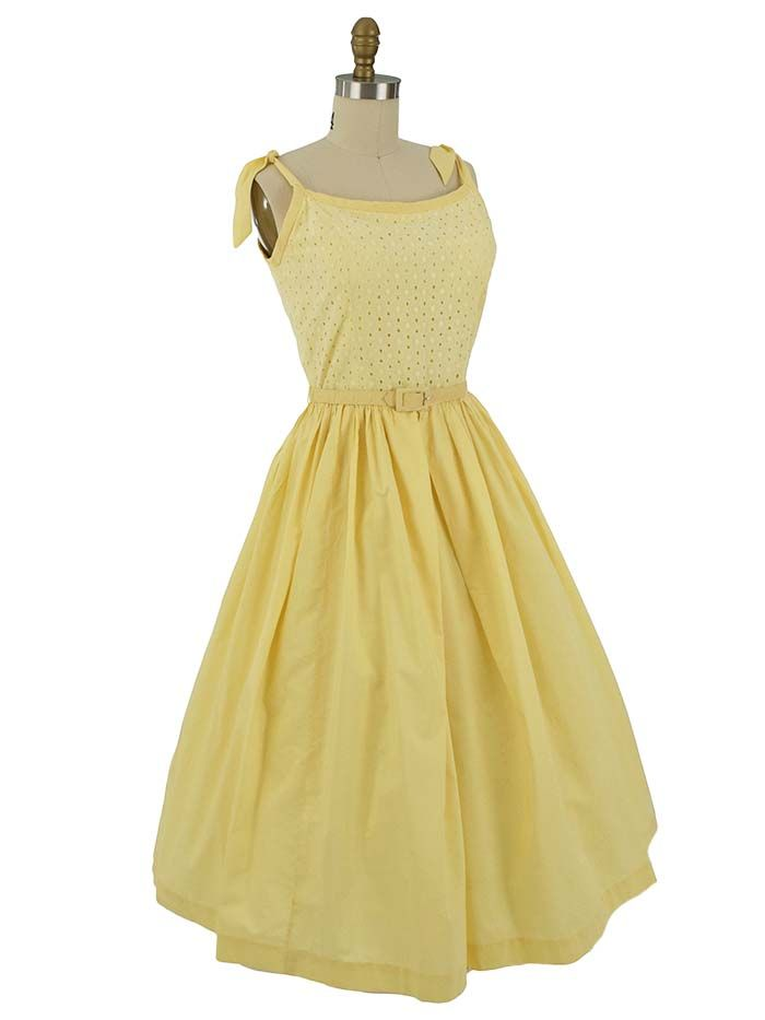 Summery butter yellow vintage sundress with pretty eyelet bodice and full midi length skirt. Great garden party look or outfit for informal daytime wedding.