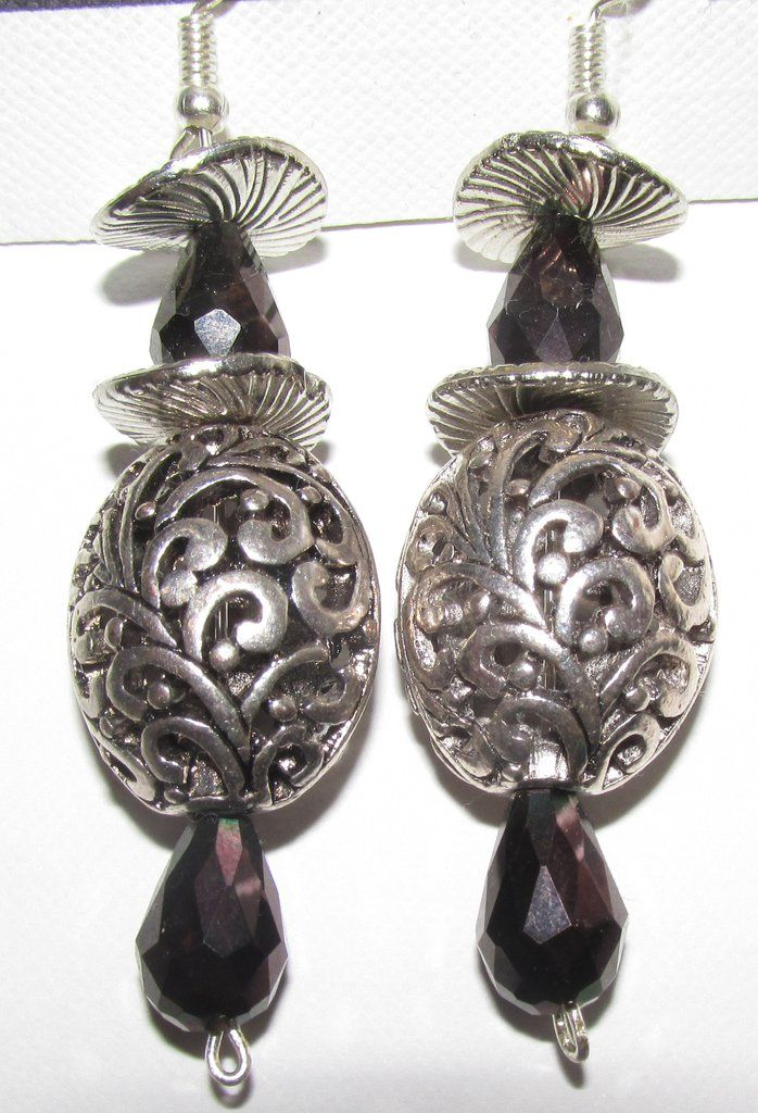 Silver swirls with Black crystals with silver locket style earrings